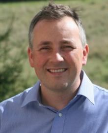 A man wearing a light blue shirt.