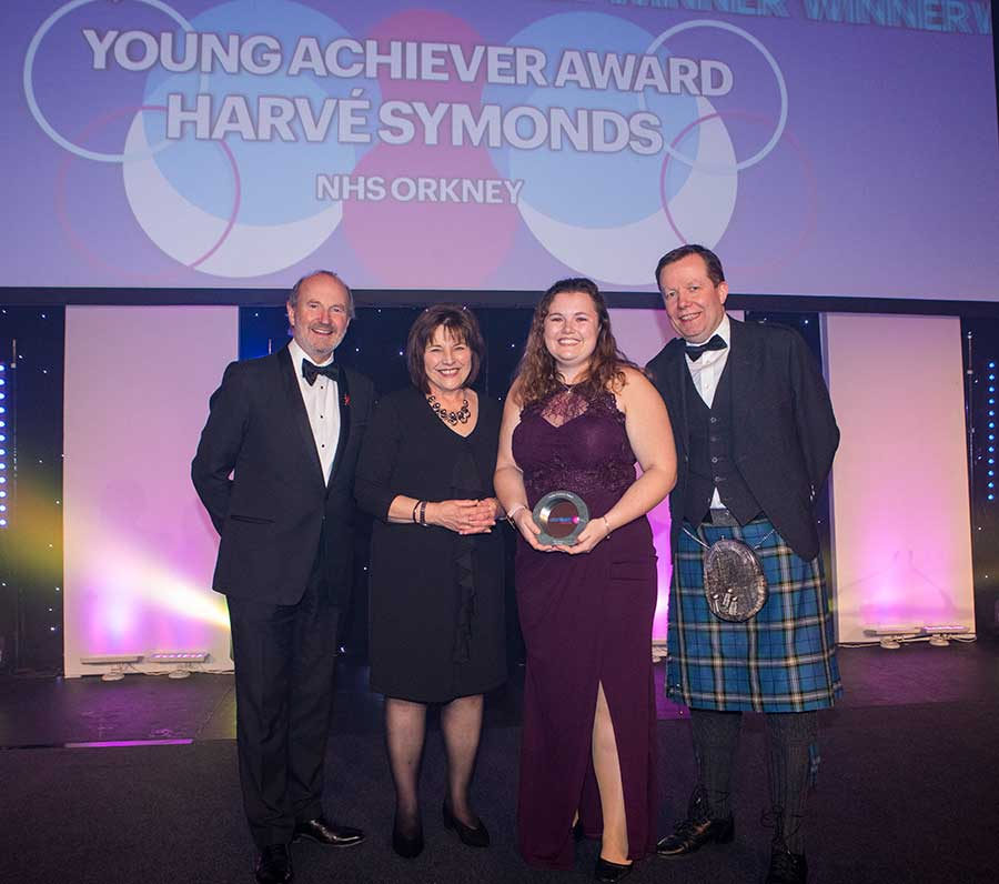A group of people holding a prize at the Scottish Health Awards