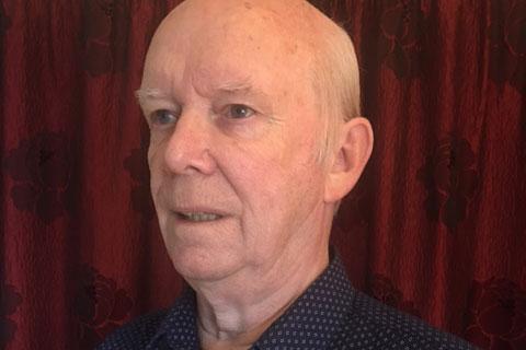 A man wearing a dark shirt.